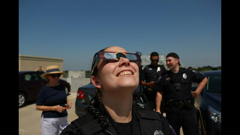 Officer Kimrey watching the solar eclipse